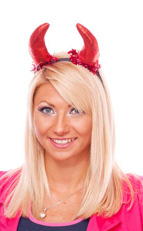 Beautiful blonde girl with red devil horns, isolated on white photo