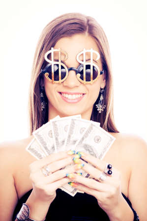 Beautiful brunette with Dollar sign glasses holding American Dollar bills - isolated on white photo