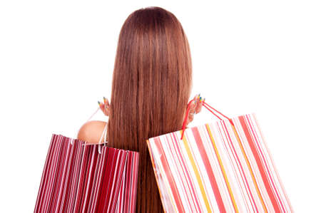 back straight: Back of young brunette with straight hair and two shopping bags over shoulder, isolated on white