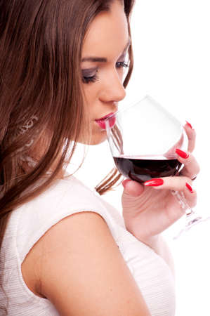 Beautiful brunette with curly hair drinking red wine, isolated on white photo
