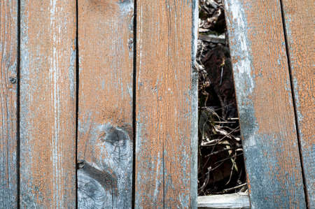 Old wooden fence with a hole. old wood background texture 版權商用圖片