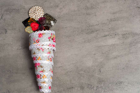 Ribbon ice cream on a grey background.Copy space