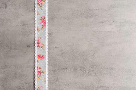 Ribbon on a grey background.Copy space.Flower ribbon.Handmade 版權商用圖片