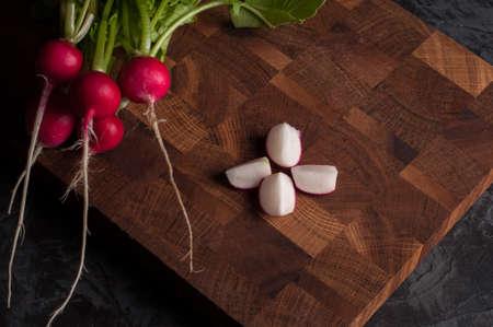 Bunch of radishes on a dark background