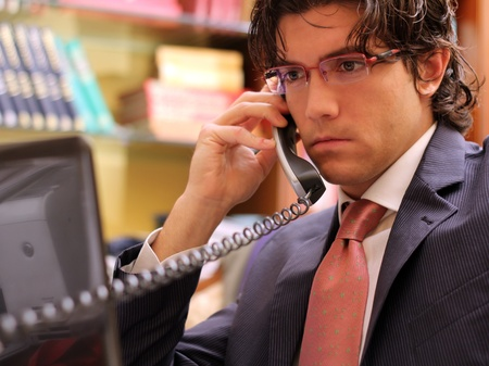 Business young man at phone  focused on the monitor Stock Photo - 11738357