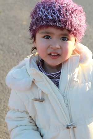 coif: Lovely child with wool coif portrait in sunset light