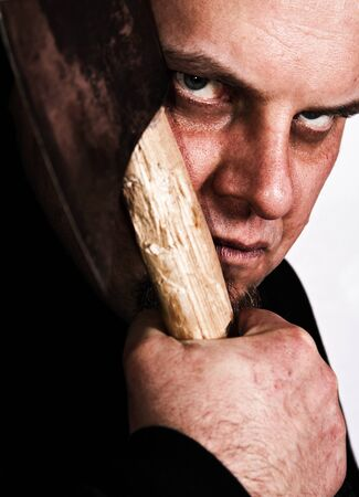 murdering: Scary gaze from mad man with an axe  Stock Photo