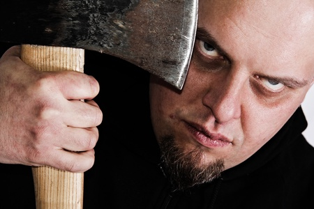 Serial killer with axe and mad gaze Stock Photo - 12005549