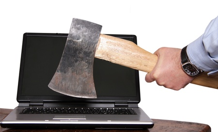 Laptop death by axe isolated Stock Photo - 12028374