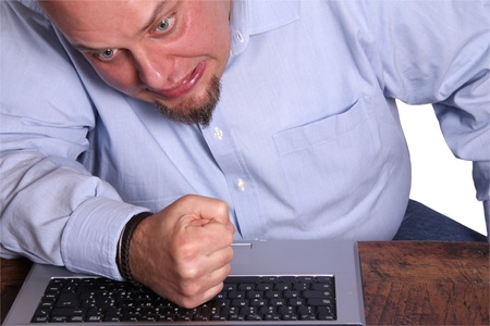 enraged: Enraged man in front of computer