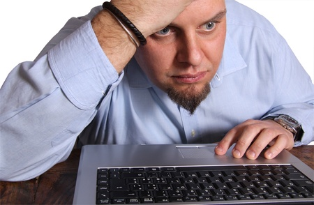 Worried man  in front of computer isolated photo