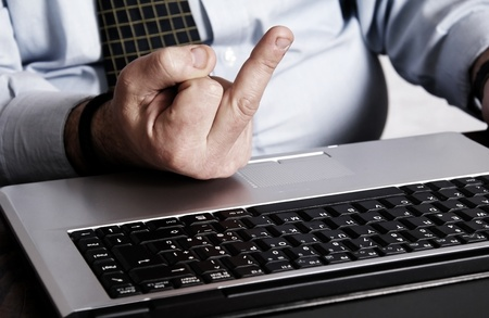 offensive: Hand gesture offensive to the laptop computer