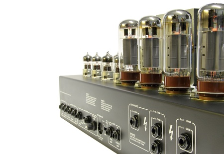 Vintage style amplifier with glass vacuum tube . Isolated with clipping path .  photo