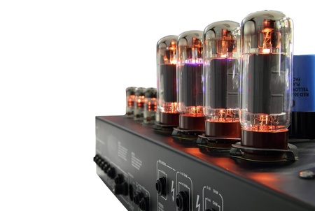 Amplifier with glass vacuum radio tubes on . Isolated image with clipping path.