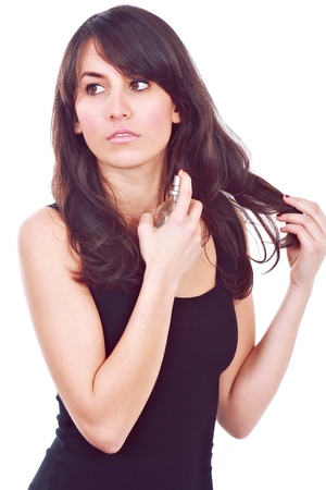 perfume woman: Fashion girl using a fragrance on her neck against white background.