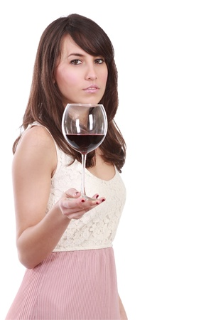 A young and attractive woman holding and offering a red wineglass , isolated with clipping path . Stock Photo - 12472680