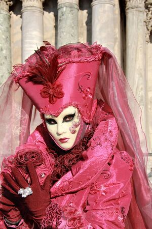 Elegant  purple and pink lady with mask . velvet dress and  veil . 2012 Venice Carnival .  photo