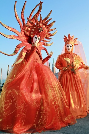 Magnificient masked couple in San Marco square . 2012 Venice Carnival . Stock Photo
