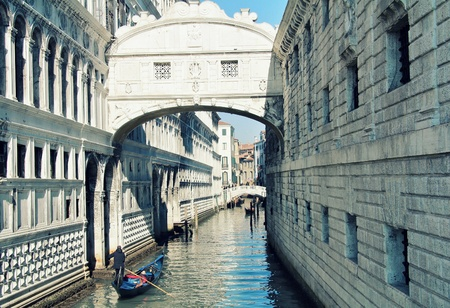 judged: Venetian famous  Bridge of sighs   with canal and gondola . Through this bridge passed prisoner to be judged and from this the name .