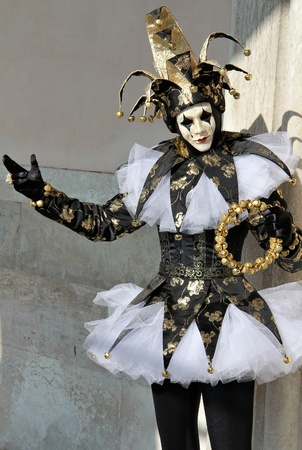Well dressed joker in black and gold    Venice Carnival 2012