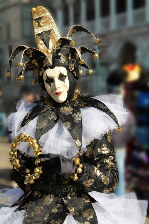 Elegant joker portrait in San Marco square  Flou effect on crowd around   Venice 2012 Carnival photo