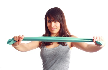 rubber bands: Slim and healthy young girl training with elastic band Stock Photo