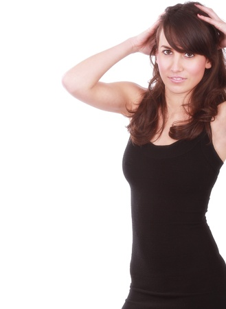 Young attractive girl in fashion pose with hand on head   On white Stock Photo - 12797586