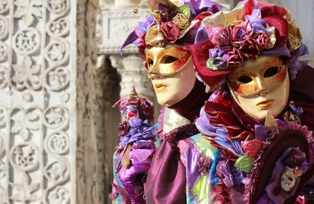 A couple of purple jokers   Marble column as background   Venice carnival 2012 Stock Photo