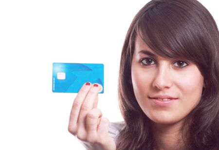 Young pretty girl with credit card in hand. Original designed of the card changed Stock Photo - 12797635