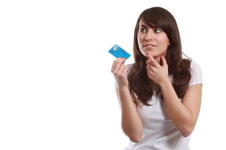 Young girl with credit card in hand has decided her next purchase Stock Photo - 12797633