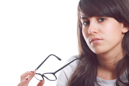 Attractive young girl with glasses in hand looking boldly at the camera Stock Photo - 12797684
