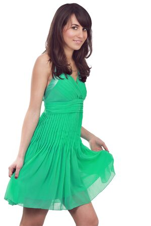 Young attractive model posing with green dress    Summer dress   Isolated on white with clipping path  Stock Photo - 12797688