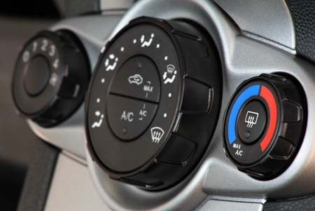 temperatures: Car temperature conditioner with panel and blue red knob . Focus on first regulation wheel Stock Photo
