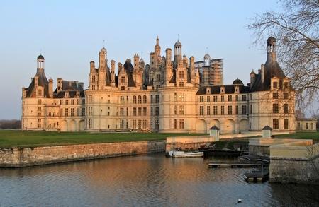 Chambord castle in Loire valley , central France  Sunset light