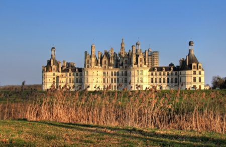 chambord: Windy sunset at Chambord castle in Loire valley , central France