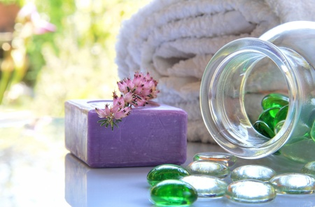 Soap and spa toiletries composition with glass pearls in natural light. Stock Photo - 13497791