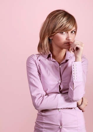 indecision: Young attractive woman has thoughtful expression and pose . Indecision conceptual Stock Photo