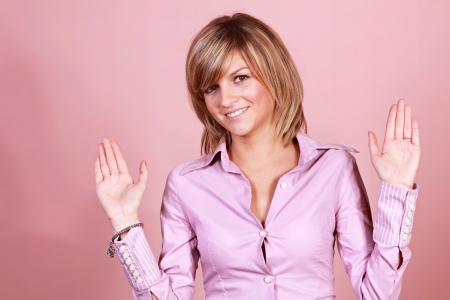 woman stop: Attractive and pretty young girl with hands up . Stop or surrender gesture. Stock Photo