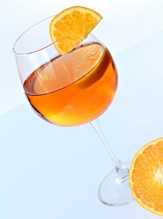spritz: Spritz cocktail and orange fruit composition . Cyan reflective surface.