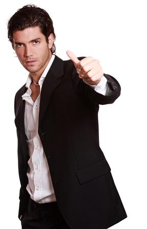 親指アップとセクシーなスタイリッシュな男。成功のコンセプト スタジオ ショットします。白で隔離されます。 写真素材