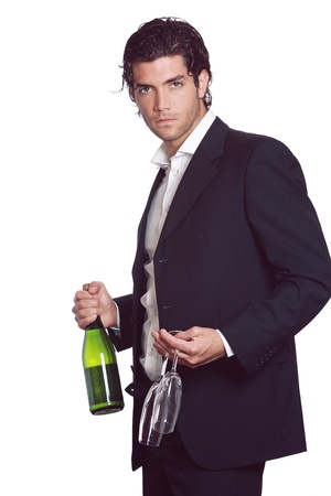 Elegant handsome man with wine bottle and two glasses in hand. Celebration concept . Isolated on white Standard-Bild