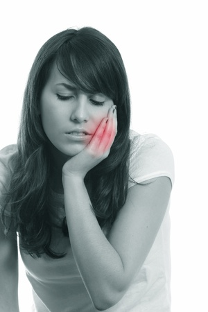 Young attractive girl with hand over her face. Toothache suffering .