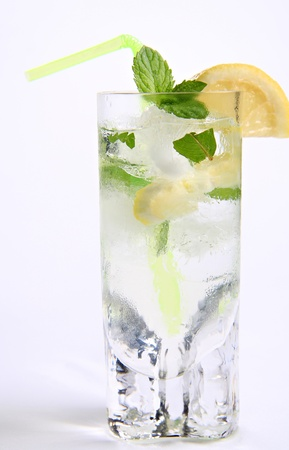 Cocktail with lemon and mint decoration . Vertical shot photo