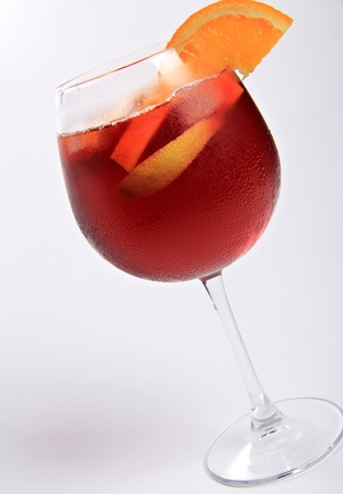 Fresh elegant glass of sangria made with fruit pieces and wine