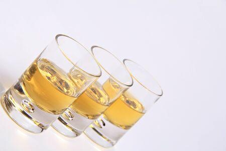 scotch whisky: Single malt whisky shots in a row   Diagonal shot Stock Photo