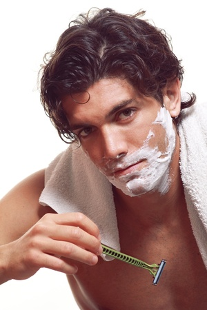 razor blade: Handsome man portrait while  shaving in the morning. Studio shot Stock Photo