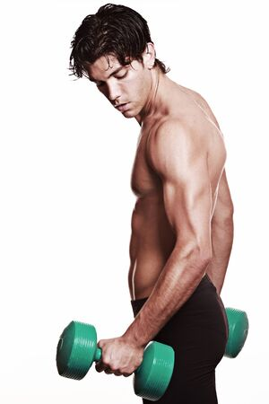 strong arm: Strong arm lifting a weight . Handsome athlete portrait. Focus on arm