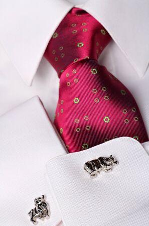 stockbroker: Stockbroker cufflinks with bull and bear shape  and stylish tie. Finance concept .