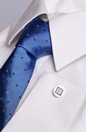 White shirt for cufflink and elegant cyan necktie   photo