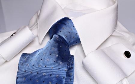 White shirt , elegant cyan necktie and blue cufflinks  photo